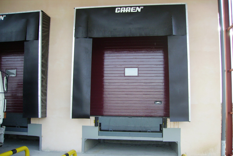 2 aplicaciones industriales puertas caren - Muelle para puertas ...